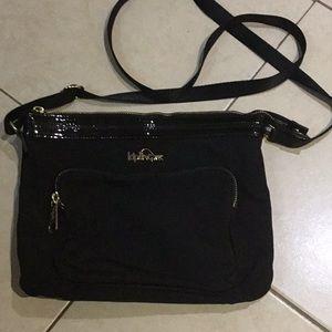 Kipling, black with gold metal detail handbag